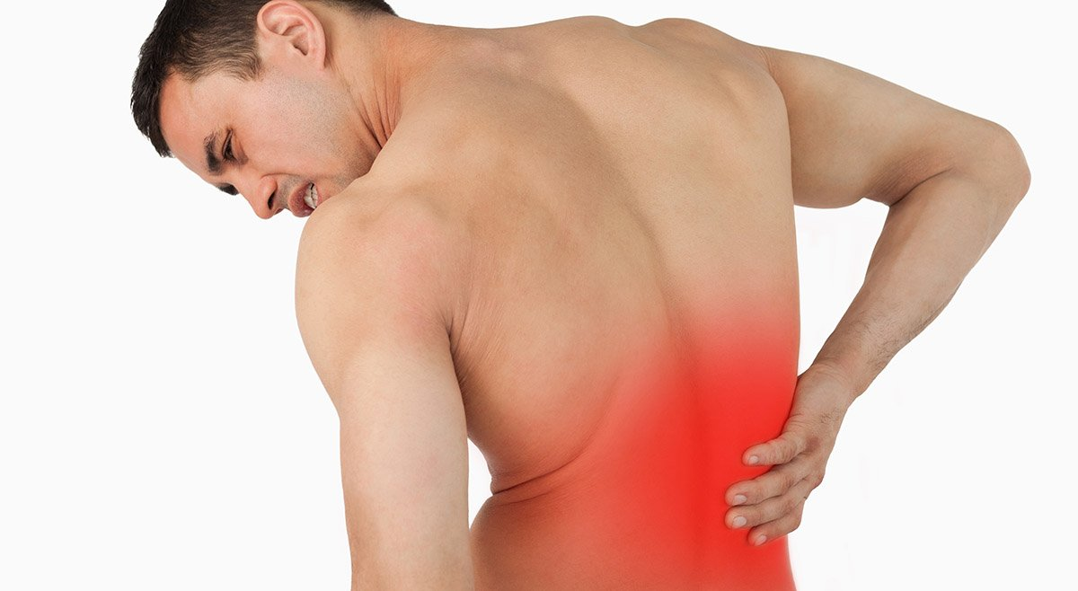 Back view of male suffering from back pain against a white background