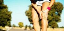 Почему болят колени